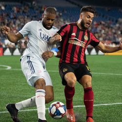 FOXBOROUGH, MA - APRIL 13: Atlanta United FC forward Hector Villalba #15 and New England Revolution defender Andrew Farrell #2 battle for the ball during the first half at Gillette Stadium on April 13, 2019 in Foxborough, Massachusetts. (Photo by J. Alexander Dolan - The Bent Musket)