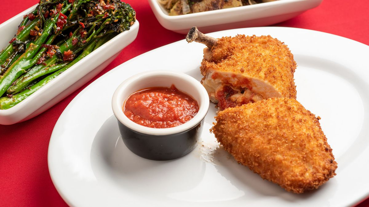 Crispy chicken cutlet served with tomato sauce.