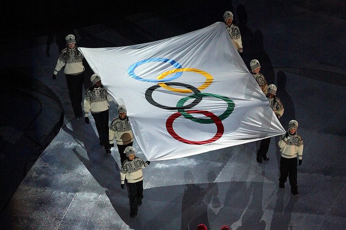 The Olympic flag is carried away during the Salt Lake 2002 Winter Olympic Games closing ceremony, Sunday, Feb 24, 2002, at the Rice-Eccles Stadium.