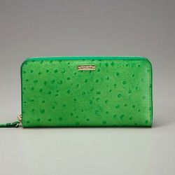 """<a href=""""http://www.gilt.com/sale/women/kate-spade-new-york-wallets-coin-purses/product/142277554-kate-spade-new-york-portola-valley-lacey-wallet"""">Portola Valley Lacey wallet</a>, $119 (was $225)"""