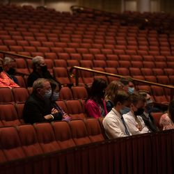 Masked attendees listen during the Saturday evening session of the 191st Semiannual General Conference of The Church of Jesus Christ of Latter-day Saints at the Conference Center in Salt Lake City on Saturday, Oct. 2, 2021.