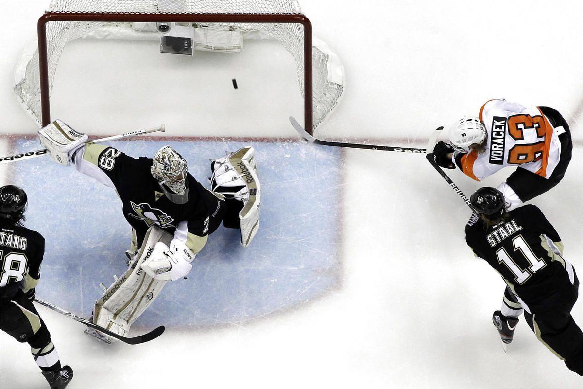Philadelphia Flyers' Jakub Voracek (93) scores in overtime past Pittsburgh Penguins goalie Marc-Andre Fleury.