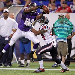 Aug 9, 2013; Minneapolis, MN, USA; Minnesota Vikings wide receiver Cordarrelle Patterson (84) drops a pass defended by Houston Texans cornerback A.J. Bouye (34) during the second quarter at the Metrodome.