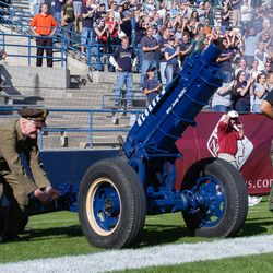 Gail Halverson, the Berlin Candy Bomber, fires George Q during a BYU football game in 2003. The cannon has been fired by the ROTC after every BYU score during football games at LaVell Edwards Stadium in Provo, Utah, since 1992.