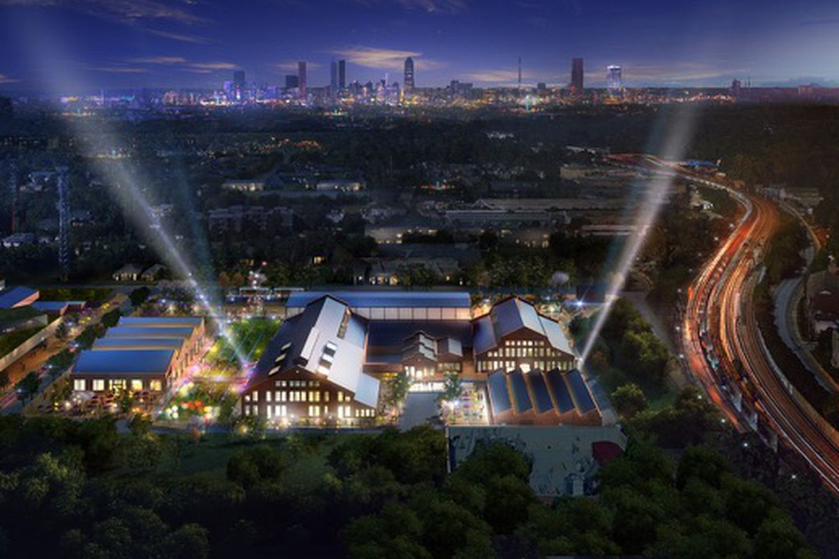 Rendering of Pratt Pullman District at night with two searchlights and the Atlanta skyline in the background