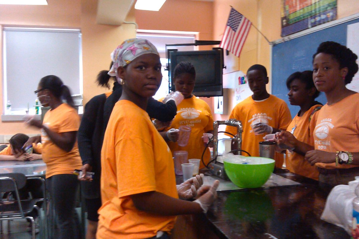 Jennifer Rosario (right), a social worker with Partnership with Children, teaches students from the South Bronx Academy for Applied Media to make smoothies during last year's Summer Quest program.