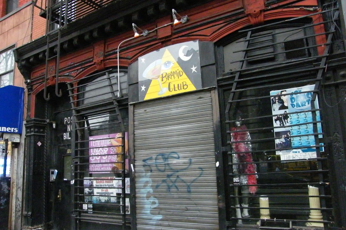 The exterior of the East Village bar Pyramid Club with its grates closed