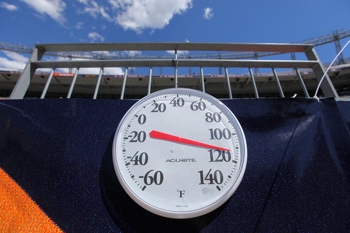 DENVER - SEPTEMBER 04, 2010:  A thermometer on the field behind the bench at INVESCO Field at Mile High Stadium predicts a TORIID outcome?  The Rocky Mountain HIGH? (Photo by Doug Pensinger/Getty Images)