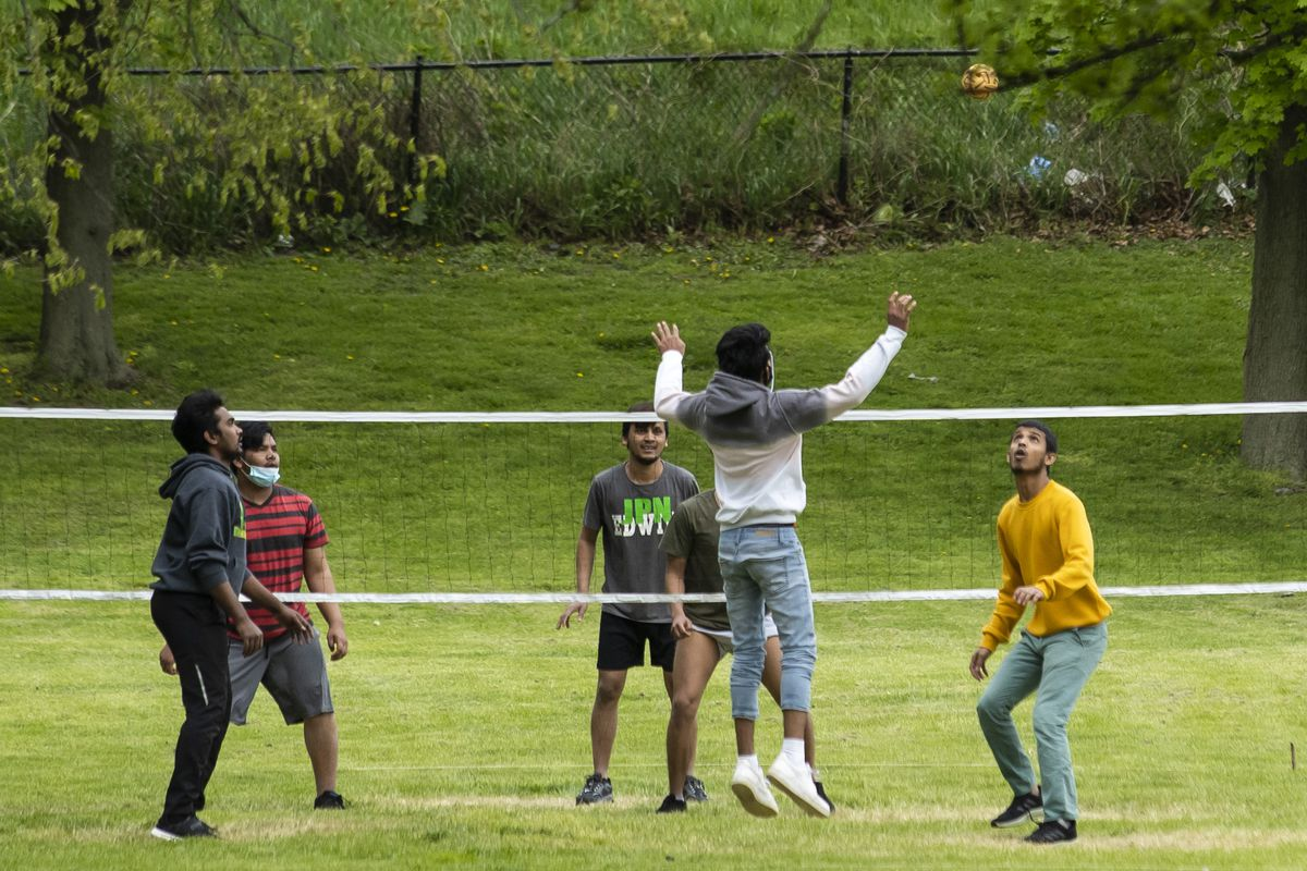 A group plays footvolley in Warren Park in the West Ridge neighborhood on the North Side, Wednesday afternoon, May 13, 2020.