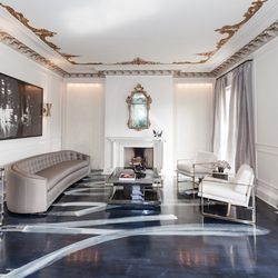"""<a href=""""http://www.catherinekwong.com/"""">Catherine Kwong Design</a> got the highly coveted living room, which is the first room you see when you enter the home. Catherine's design was inspired by """"Mick and Bianca Jagger—the early years."""" From the de"""