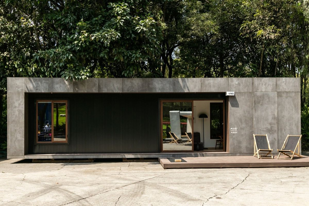 House clad in concrete and metal panels.