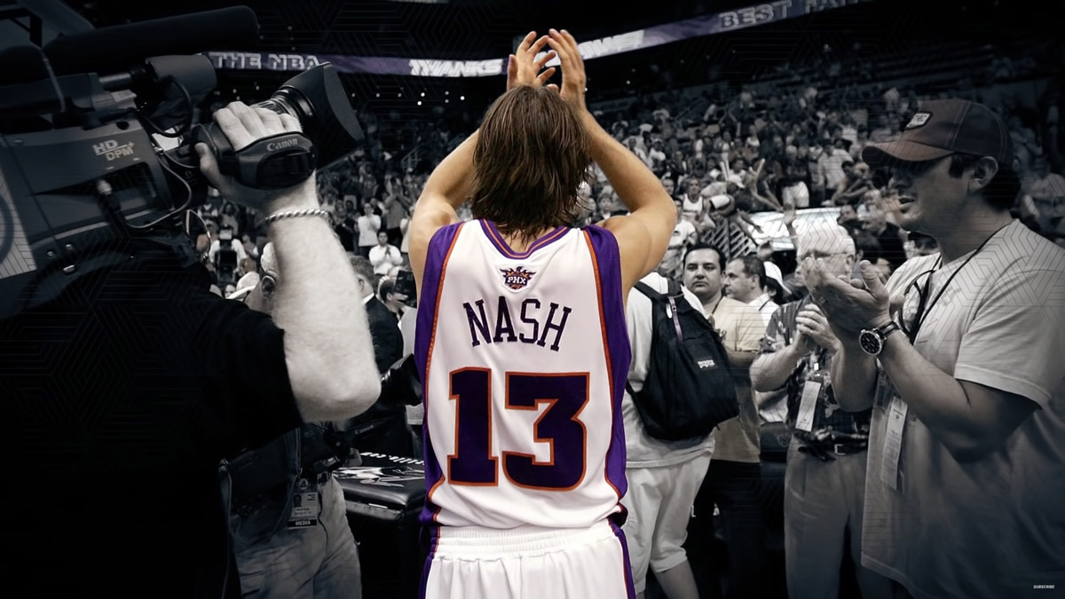 Steve Nash walks off the court with his hands raised in appreciation.