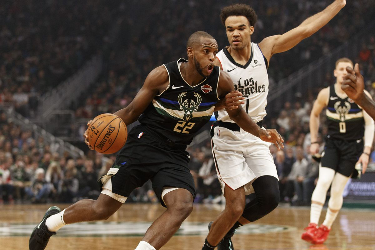 Milwaukee Bucks forward Khris Middleton drives for the basket against Los Angeles Clippers guard Jerome Robinson during the first quarter at Fiserv Forum.