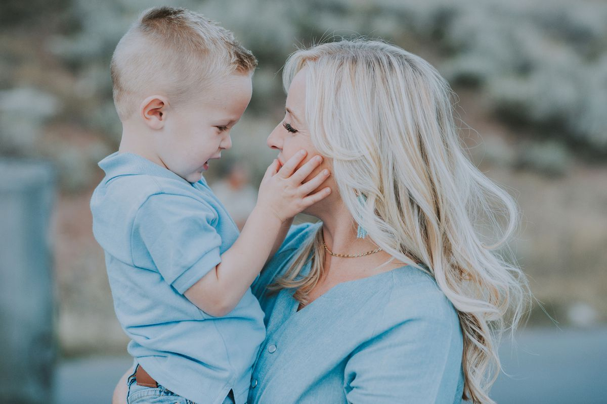 Carmen Herbert's youngest son touches her skin.