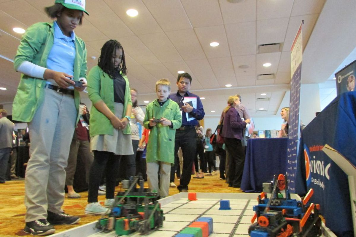 Students from Paramount School of Excellence's robotics team show off their skills at the Indiana Afterschool Network's Summit on Out of School Learning at the JW Marriott hotel in Indianapolis.