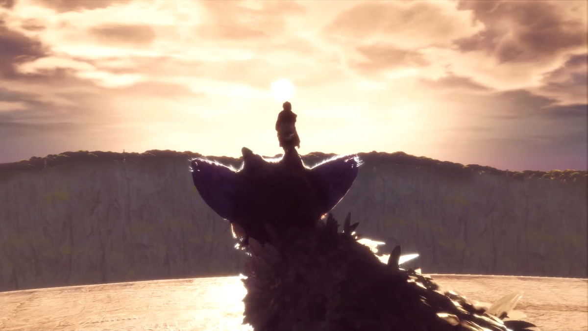The hero of The Last Guardian stands on his companion's head during a quiet moment in the game