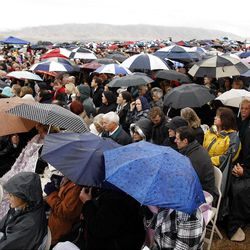 Thousands sit in the rain waiting for the ceremony to start Saturday, Oct. 8, 2011 for the ground breaking for the Payson Temple.