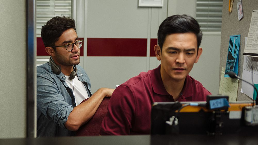 Director Aneesh Chaganty and star John Cho on the set of Searching