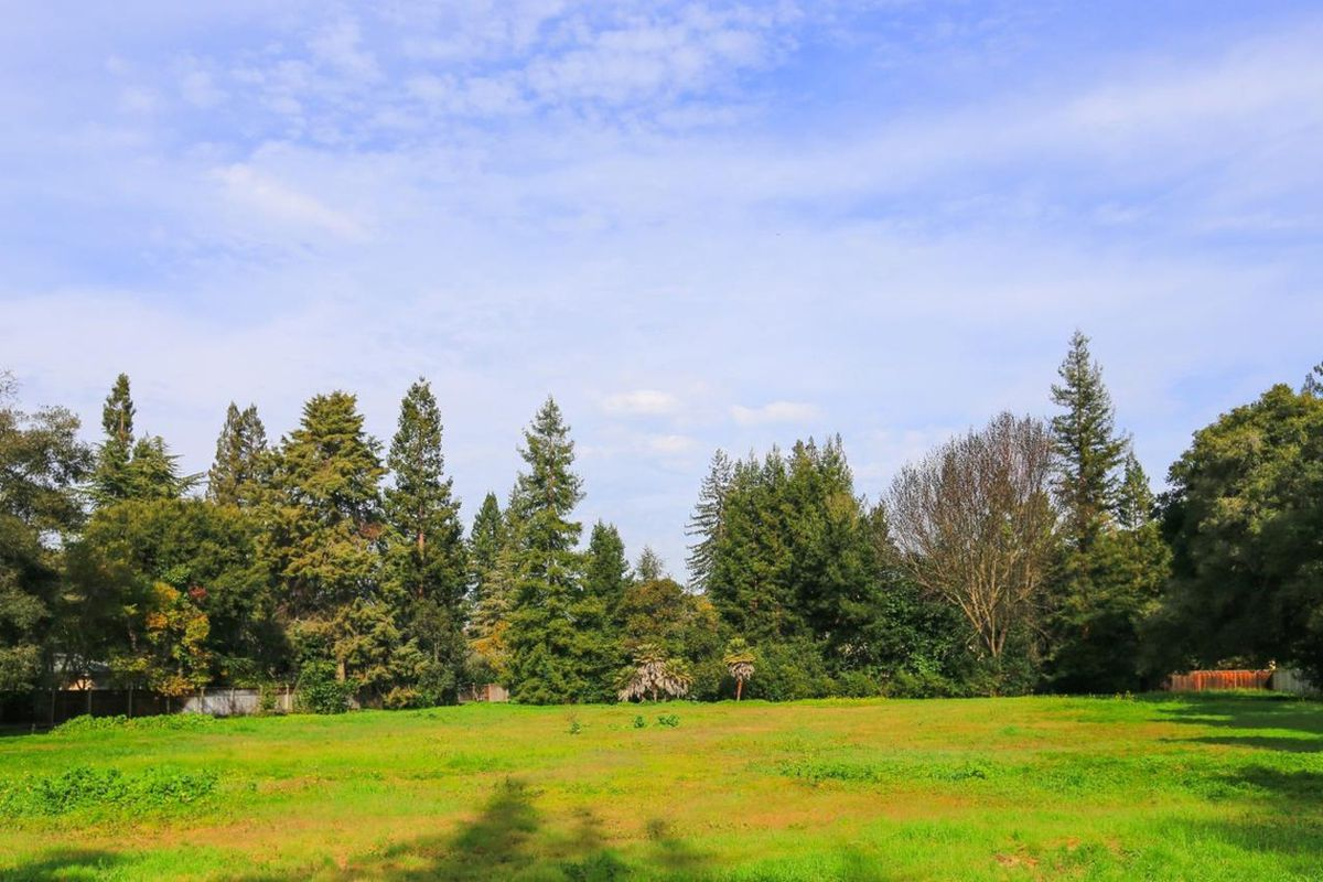 A grassy, tree-lined lot in Atherton.