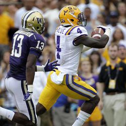 LSU running back Alfred Blue (4) rushes past Washington safety Will Shamburger (13) for a touchdown during the first half of an NCAA college football game in Baton Rouge, La., Saturday, Sept. 8, 2012.