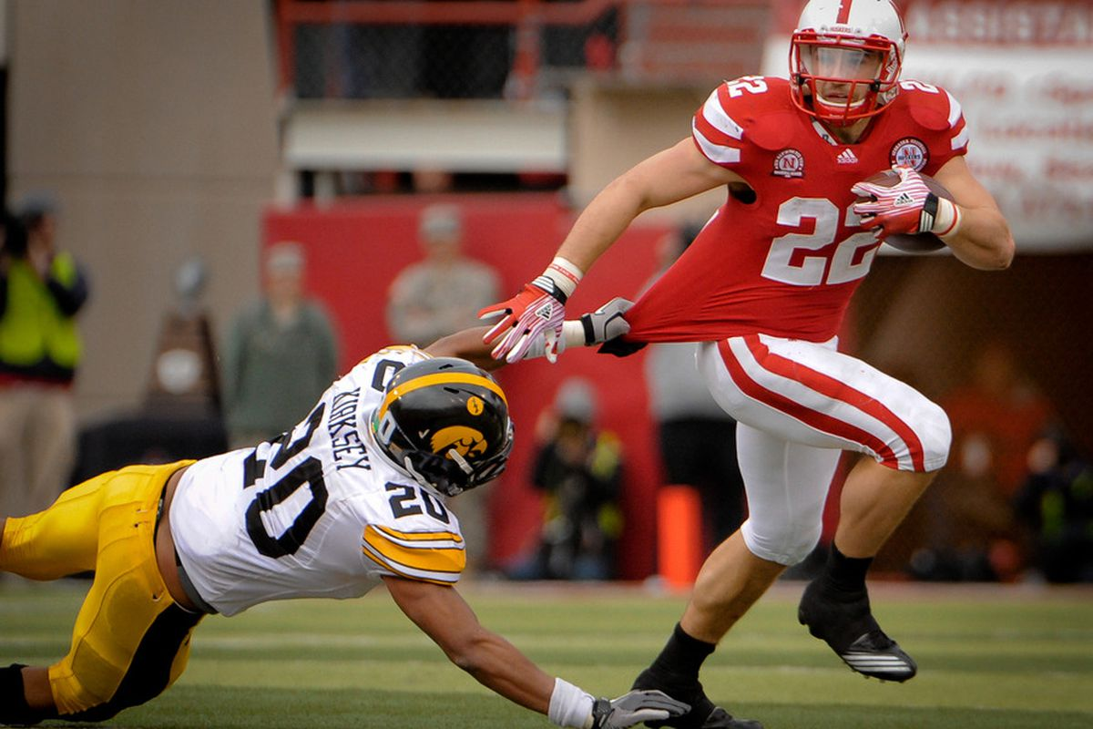 LINCOLN, NE - NOVEMBER 25: Running back Rex Burkhead #22 of the Nebraska Cornhuskers wins every poll he's in. That seems like reason enough to put his picture on this post. (Photo by Eric Francis/Getty Images)