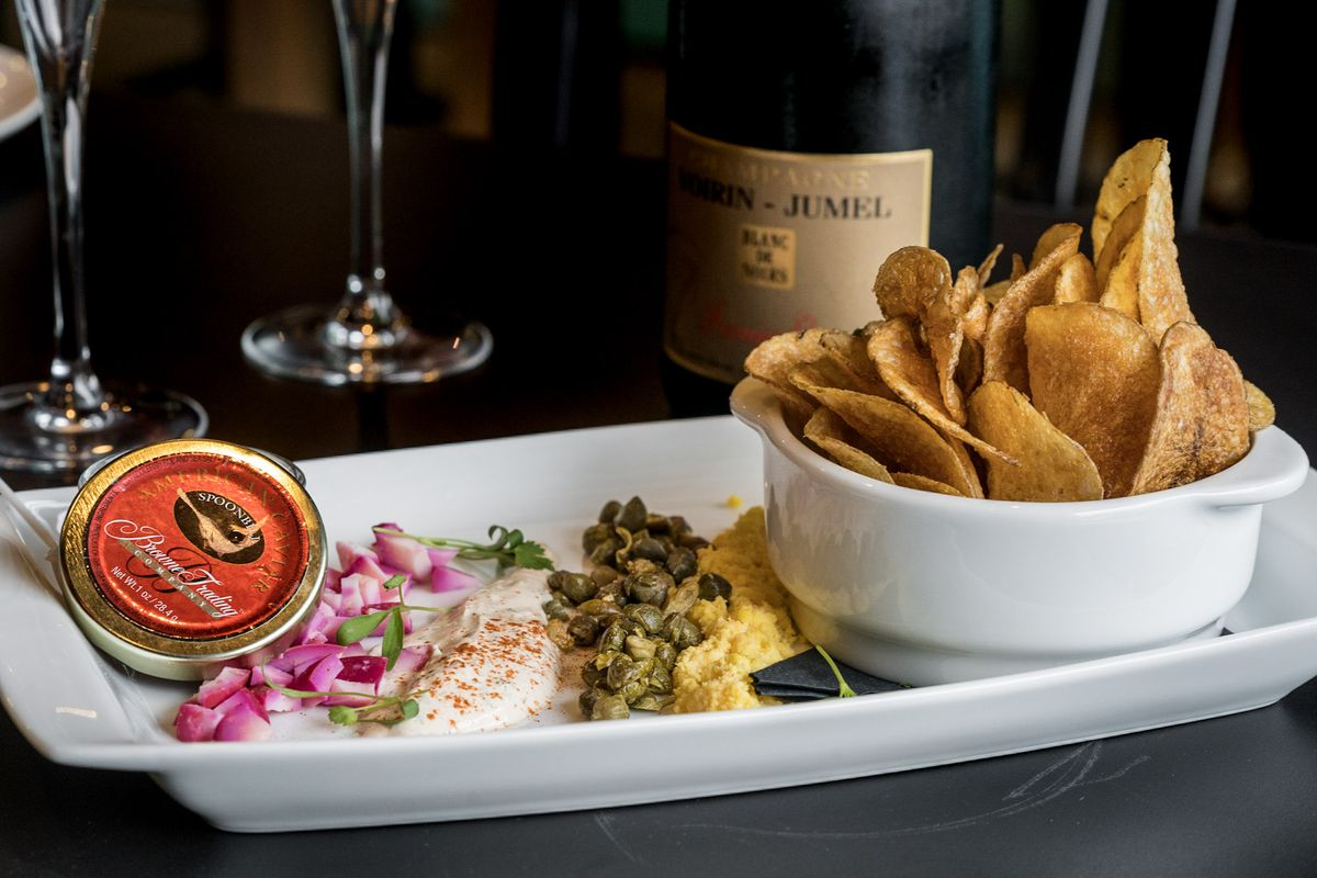 The Eleanor's $35 chip and caviar starter includes sour cream ranch and garnishes.