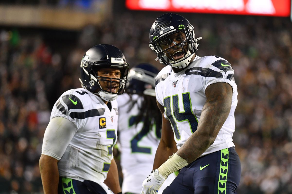 Seattle Seahawks wide receiver D.K. Metcalf reacts after his touchdown reception as quarterback Russell Wilson looks on during the third quarter against the Philadelphia Eagles in a NFC Wild Card playoff football game at Lincoln Financial Field.