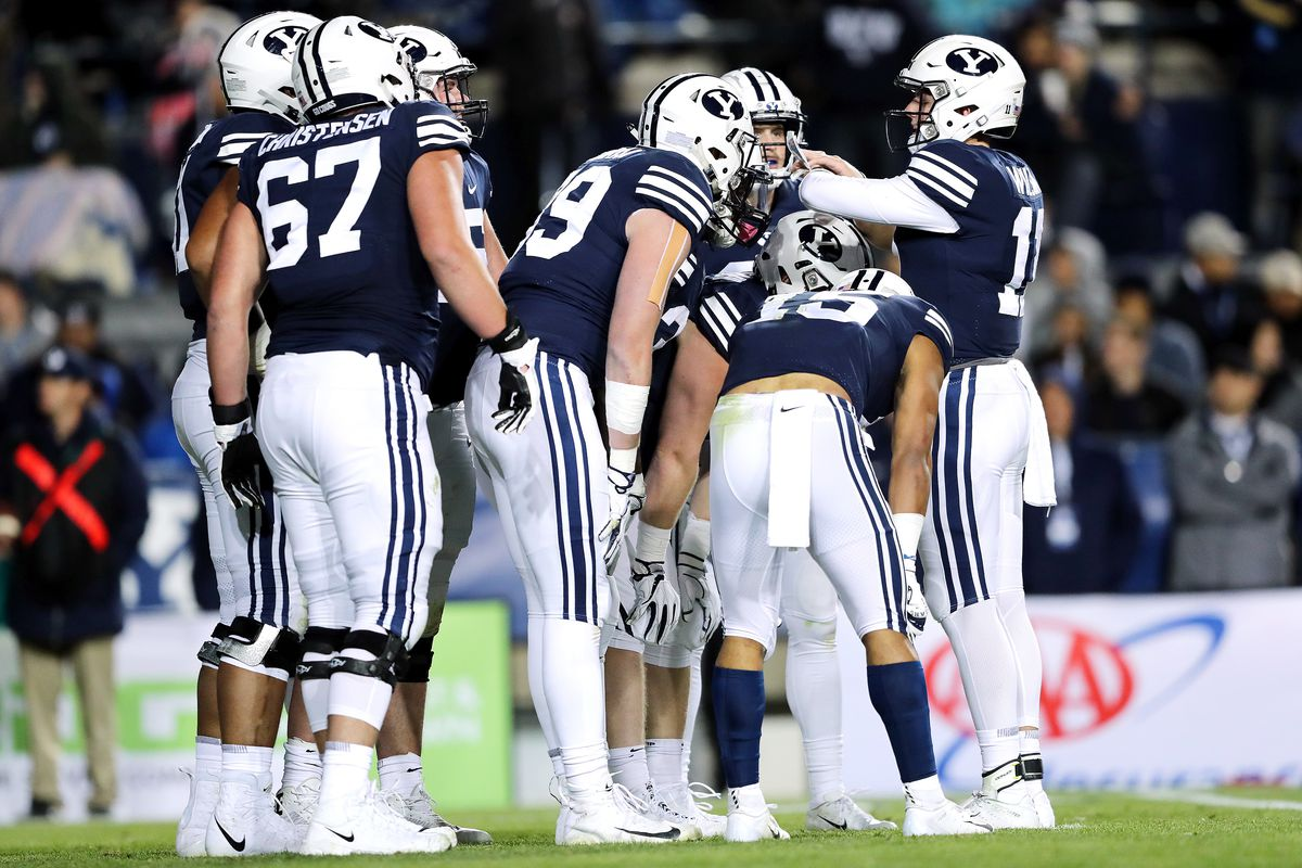 Brigham Young Cougars quarterback Zach Wilson (11) gives the play in the huddle as BYU and Hawaii play at LaVell Edwards Stadium in Provo on Saturday, Oct. 13, 2018. BYU won 49-23.