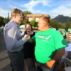 Jonathan Johnson talks with his brother, Bradford, and sister-in-law, Cynthia Johnson, during party at Johnson's headquarters as they wait for voting results in the primary elections for Utah's governor on Tuesday, June 28, 2016.