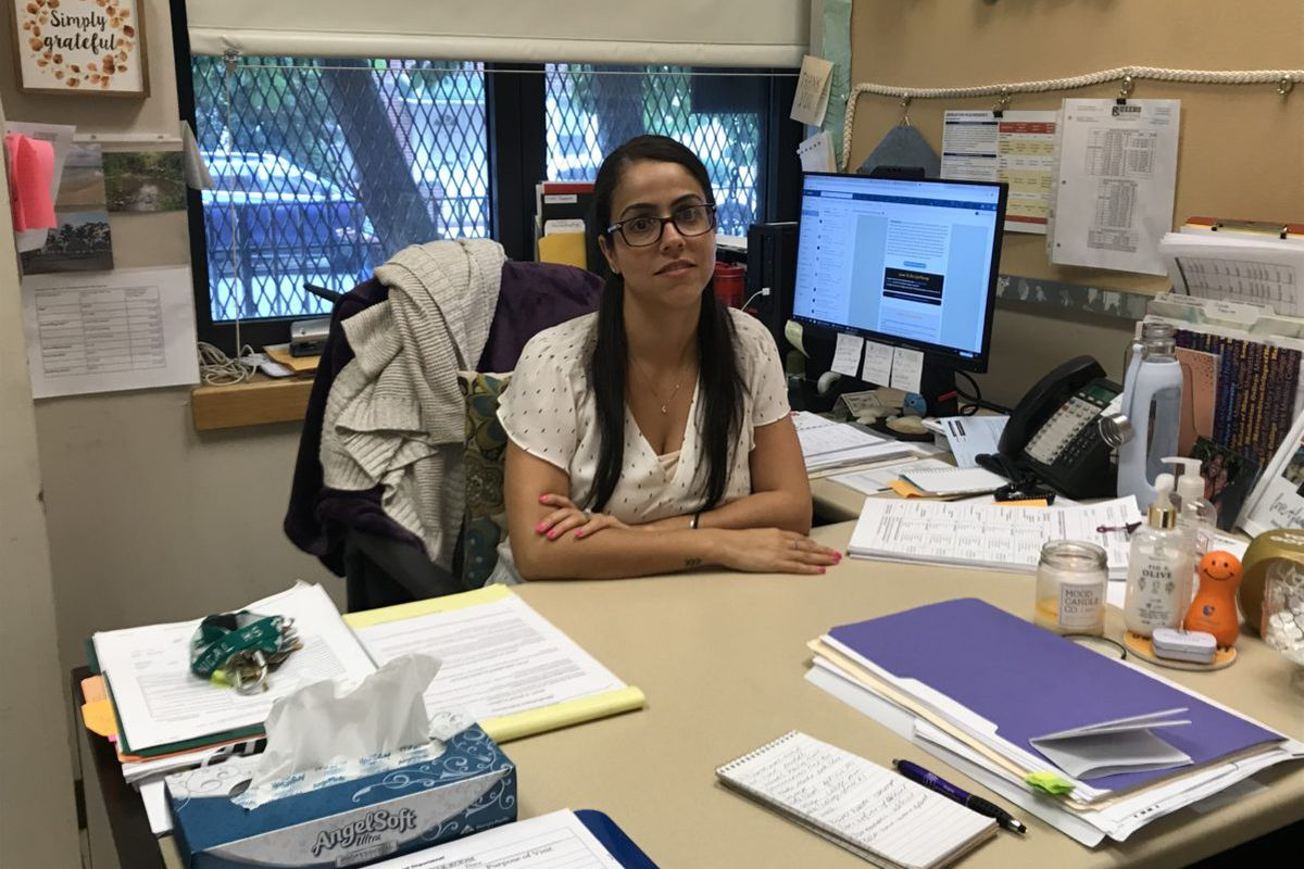 College counselor Anna Karabelas sits in her office at Queens Technical High School, where she exposes students to the college application process.