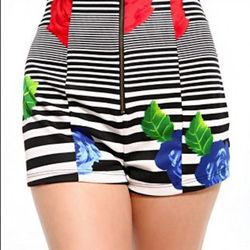 """What's even trendier than stripes and floral print, which are two of the season's staples? An item that blends both these classics. $24.90, <a href=""""http://www.shopakira.com/products/print-striped-scuba-knit-shorts.html"""">Akira</a>"""