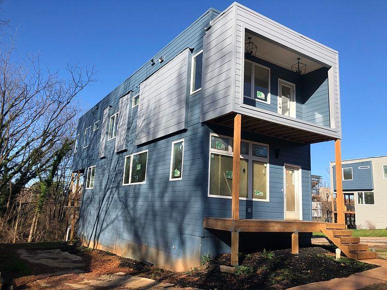A blue and light blue modern house in Atlanta's Summerhill neighborhood.
