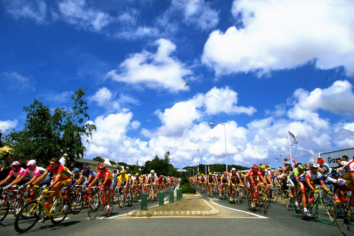 The peleton is split by the central reservation as the helicopter watches from above