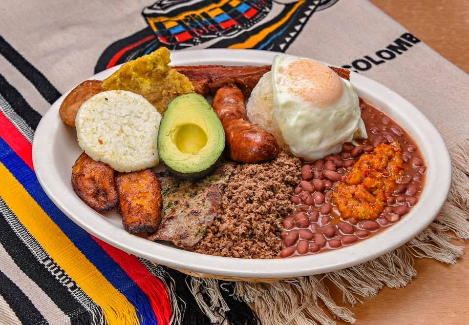 A brunch dish of eggs, rice, beans, and avocado from El Parche Colombiano