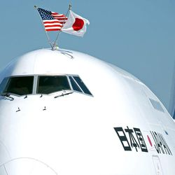 The plane carrying Japanese Prime Minister Yoshihiko Noda flies American and Japanese flags during arrival at Andrews Air Force Base, Md., Sunday, April 29, 2012. President Barack Obama will meet with Noda at the White House, Monday, April 30, 2012.