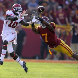 Utah wide receiver DeVonte Christopher, left, catches a pass as Southern California safety T.J. McDonald defends during the first half of their NCAA college football game on Saturday, Sept. 10, 2011, in Los Angeles, Calif.  (AP Photo/Mark J. Terrill)