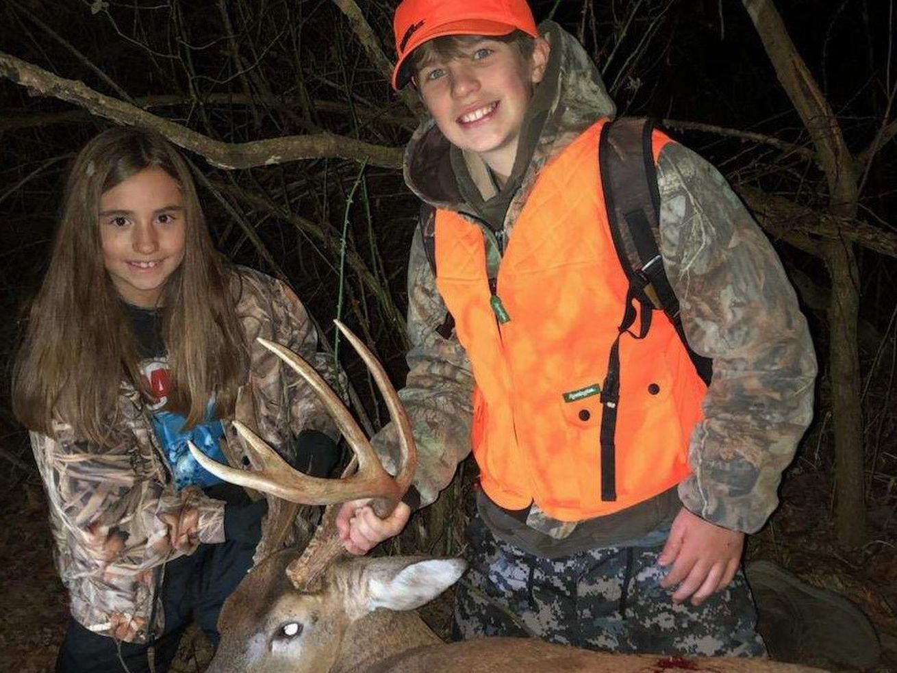 """Jonas Gregory (right) poses with his buck and his sister Magnolia """"Maggie"""" Gregory. Provided photo"""