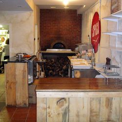The wood-fired brick oven.