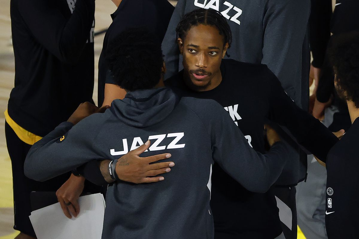 Donovan Mitchell of the Utah Jazz and DeMar DeRozan of the San Antonio Spurs congratulate each other after the game at The Field House at ESPN Wide World Of Sports Complex on August 13, 2020 in Lake Buena Vista, Florida.