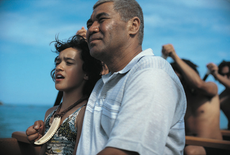 Pai and her grandfather ride a boat in Whale Rider