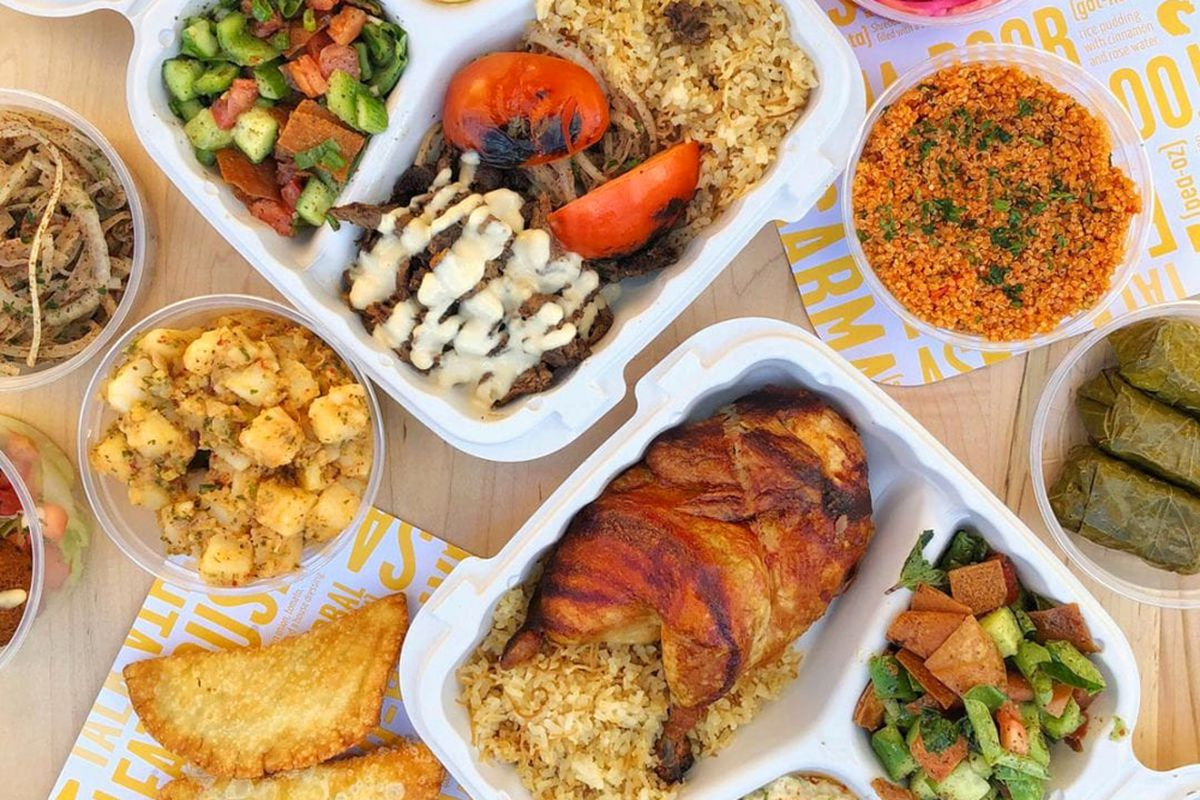 A table filled with chicken, falafel and beef dishes on the menu at Bok Bok Chicken, coming soon to Town Square.