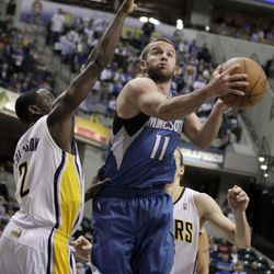 Minnesota Timberwolves guard J.J. Barea, right, gets a basket on a shot around Indiana Pacers guard Darren Collison during the first half of an NBA basketball game in Indianapolis, Monday, April 16, 2012.