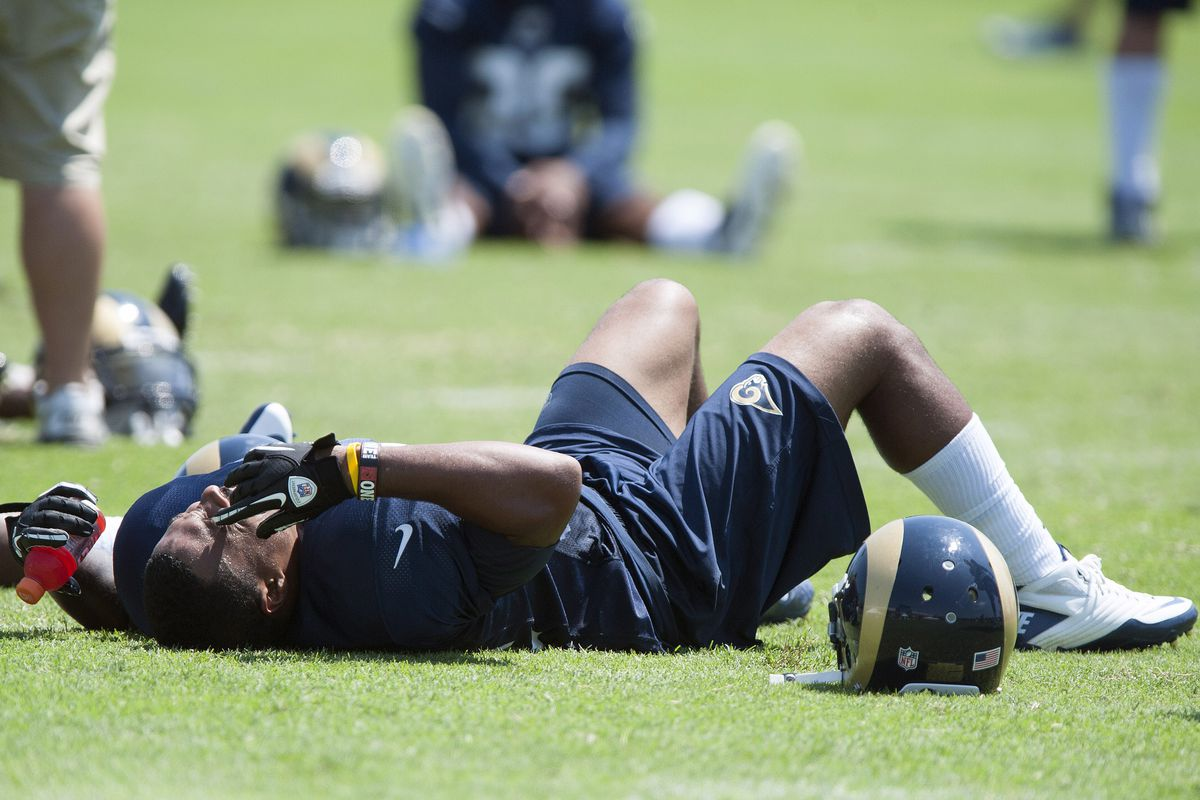 July 27, 2012; St. Louis, MO, USA; St. Louis Rams running back Isaiah Pead (24) collapses on the grass after training camp at ContinuityX Training Center. Mandatory Credit: Jeff Curry-US PRESSWIRE