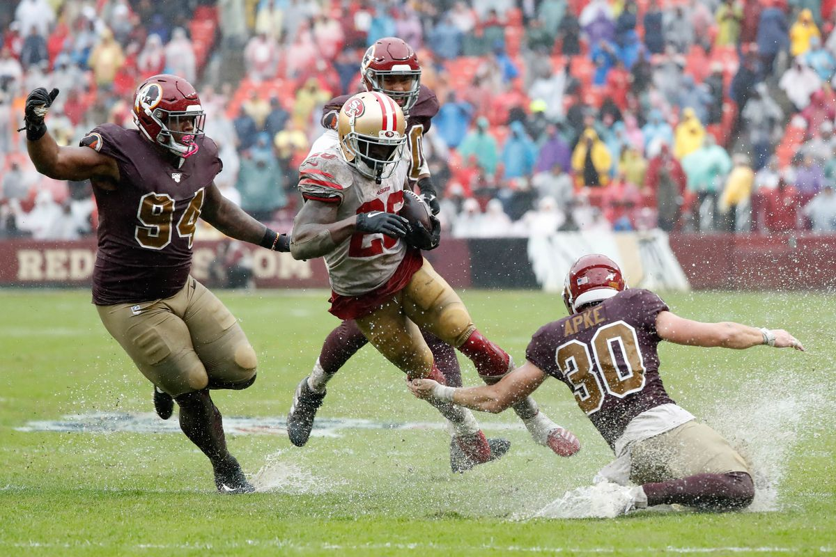 San Francisco 49ers running back Tevin Coleman carries the ball past Washington Redskins nose tackle Daron Payne and Redskins defensive back Troy Apke at FedExField.