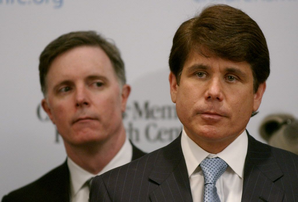 Gov. Rod Blagojevich, right, fields questions from reporters as State Comptroller Dan Hynes stands behind the governor at a 2005 news conference. File photo by John J. Kim/Sun-Times