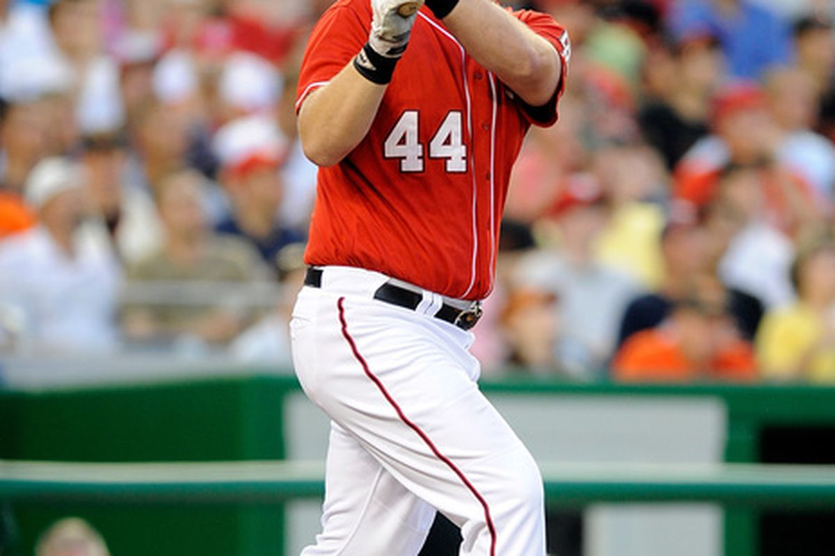 WASHINGTON - JULY 09:  Adam Dunn #44 of the Washington Nationals hits a home run in the fourth inning against the San Francisco Giants at Nationals Park on July 9 2010 in Washington DC.  (Photo by Greg Fiume/Getty Images)