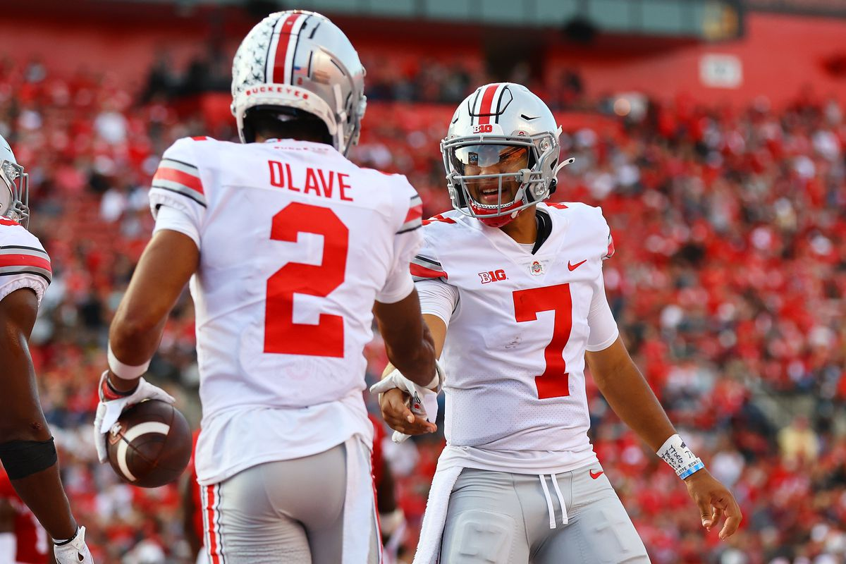Chris Olave of the Ohio State Buckeyes celebrates scoring a touchdown with C.J. Stroud against the Rutgers Scarlet Knights at SHI Stadium on October 02, 2021 in Piscataway, New Jersey.