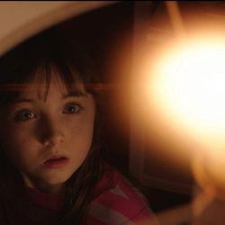 """Madison Bowen (Kennedi Clements) reacts to apparitions that have invaded her family's home in the 1982 horror film """"Poltergeist,"""" one of the many films from the 1980s that the hit Netflix show """"Stranger Things"""" references. The second season of """"Stranger Things"""" will be available on Oct. 27."""