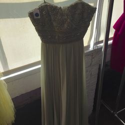 Green beaded gown, $900