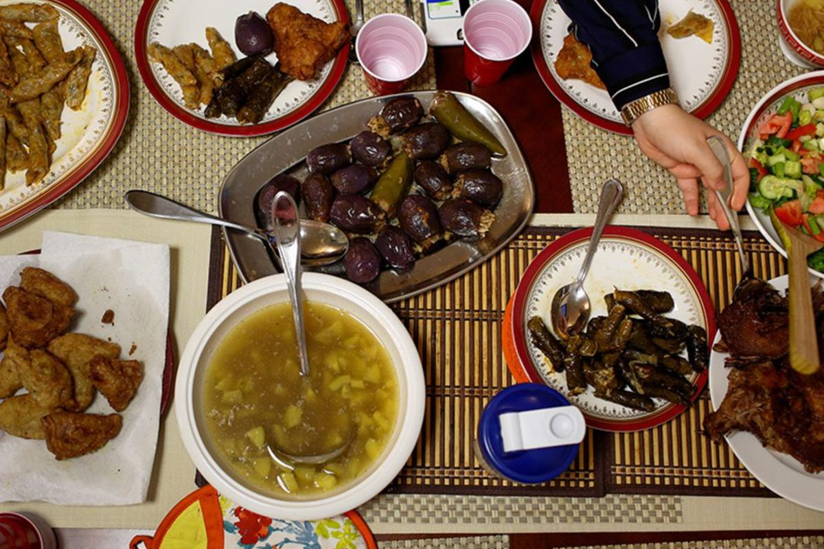 A family dines on the iftar feast, a meal eaten by Muslims after sunset during Ramadan, at their home in Manhattan on May 27, 2017.